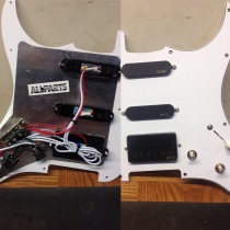 New pickgaurd wired with EMG 57 humbucker and Lukather signature singles